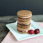Chocolate Macarons with Cherry Frosting/Milk Chocolate Ganache Filling