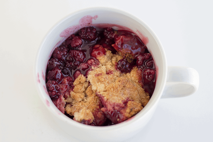 homemade cobbler with fresh blackberries served in a white mug