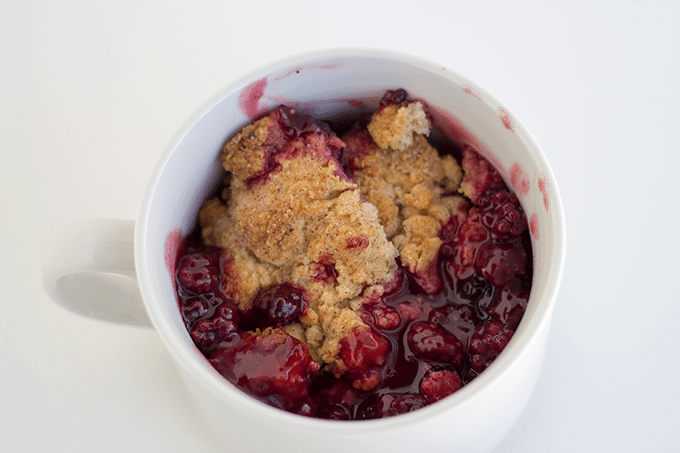 single serving of Blackberry Cobbler in a white mug
