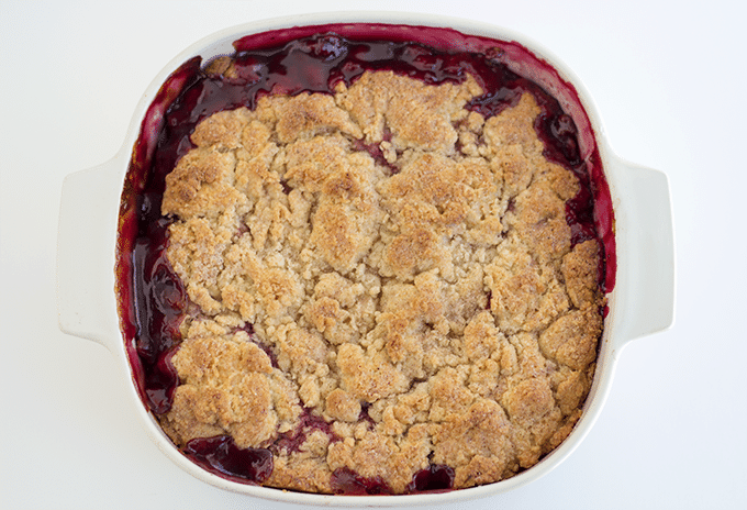 Blackberry Cobbler baked into a square white baking dish