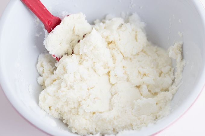 stirring ingredients to make ice cream from snow