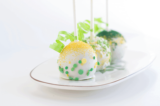 St. Patrick's Day Chocolate Chip Cake Pops on a white dessert platter