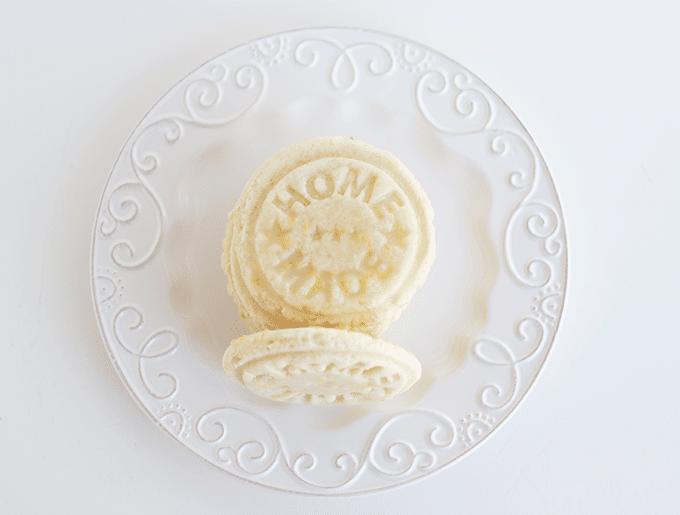 stack of homemade glazed lemon cookies on a white dessert plate