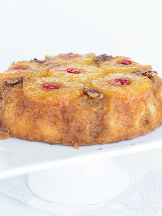 pineapple upside down cake on a white cake platter