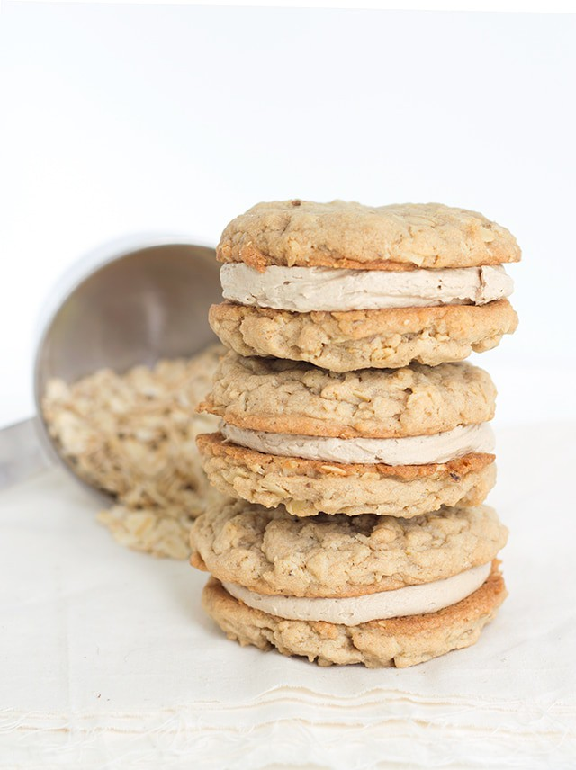stack of oatmeal cream pies with a measuring up on its side with oatmeal in it behind it