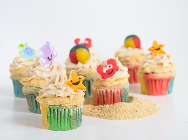 vanilla cupcakes decorated with beach themed cupcake toppers