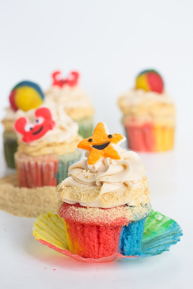 Beach Cupcakes topped with buttercream frosting and beach themed cupcake toppers