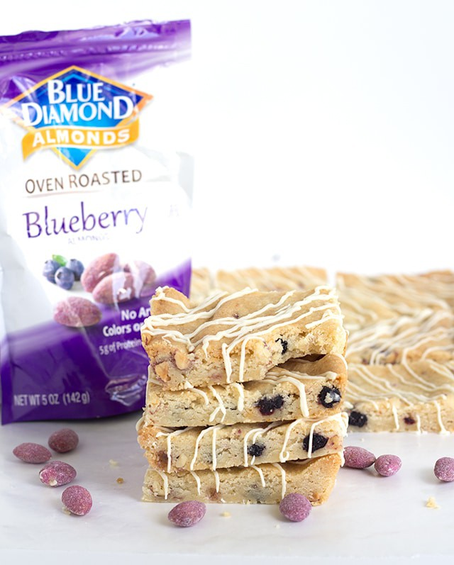 Blueberry Almond Shortbread Bars - buttery shortbread bars full of dried wild blueberries, chopped blueberry almonds and almond paste. The perfect chewy bar.