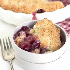 Fresh Cherry Sugar Cookie Cobbler - Fresh cherry filled cobbler with a sugar cookie topping. It's sweet and juicy!