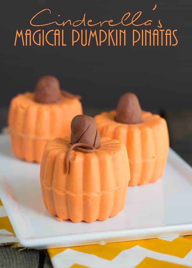 Cinderella's Magical Pumpkin Pinatas - Cute pinata pumpkins that are perfect to celebrate fall and inspired by the new Cinderella Movie! Stuff these guys with all the cute fall candy.
