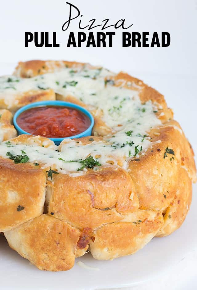 Pizza Pull Apart Bread - Fun pull apart bread with a delicious pizza filling and a garlicky exterior. This is a fun dinner if you have youngsters.