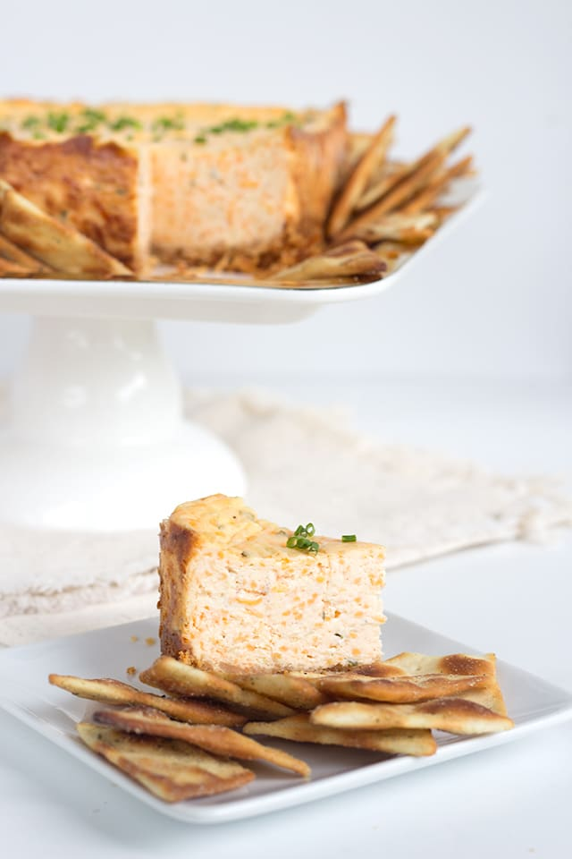 Savory Garlic and Herb Cheesecake - loaded with cheese, roasted garlic and herbs, this is the perfect addition to any cracker!