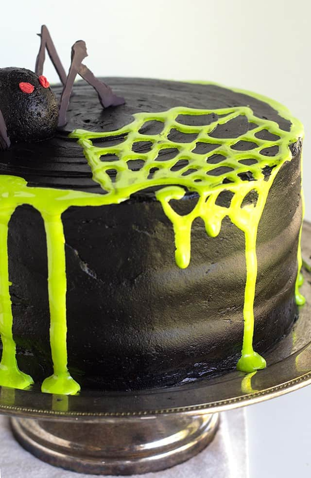 Spooky Spiderweb Cake - the perfect chocolate Halloween cake with black chocolate frosting and toxic green fluff sludge. It should be at all the parties!