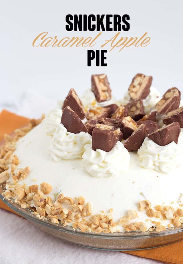 Snickers Caramel Apple Pie - delicious layers of cream cheese, caramel, crunchy, fresh apples and whipped cream. Best of all, it's topped with Snickers and peanuts. It's a quick and easy dessert too!
