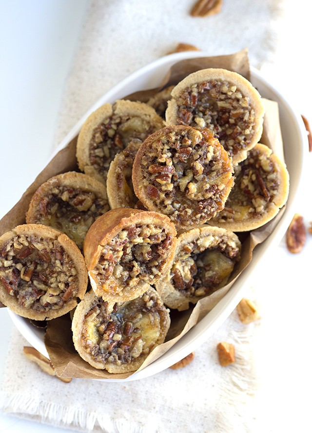 Cheesy Pecan Tassies - tiny pecan pies filled with incredibly creamy havarti cheese. These are the perfect little sweet appetizer for any occasion.