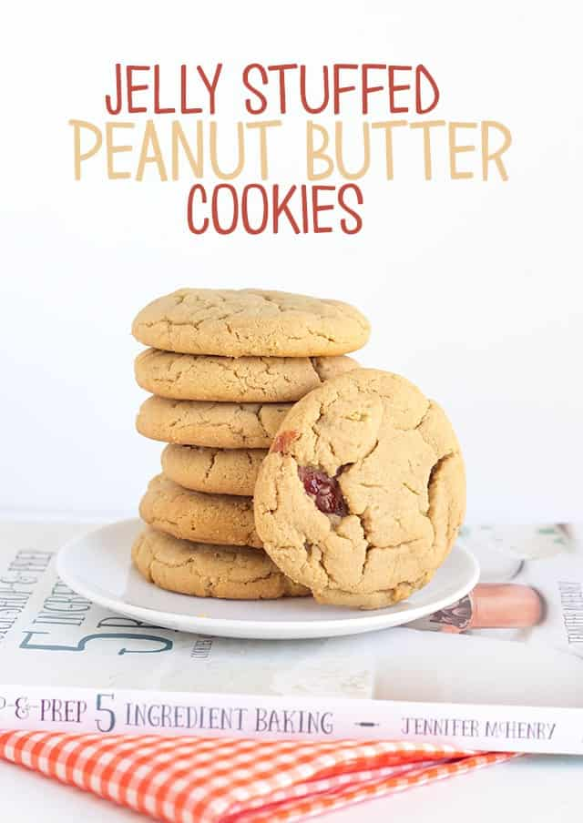 Jelly Stuffed Peanut Butter Cookies - step aside pb&j sandwiches. These cookies are soft peanut butter cookies stuffed with a strawberry jelly. Every bite has a hint of jelly!