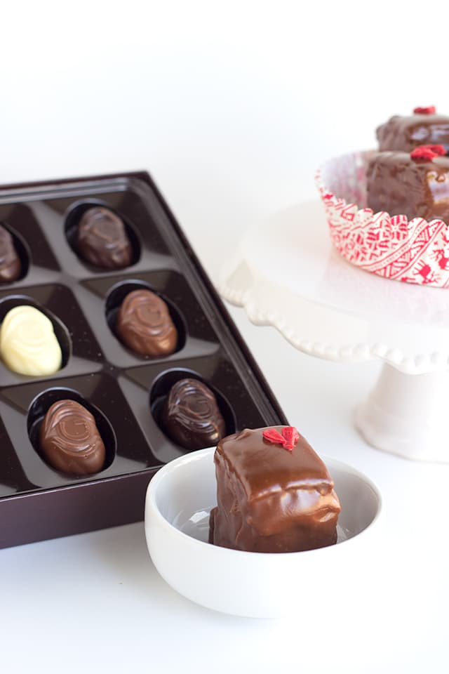 Chocolate Strawberry Petit Fours - strawberry and milk chocolate ganache layered tiny chocolate cakes that are perfect for the gift giving holiday!