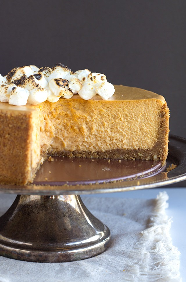 Sweet Potato Cheesecake - creamy sweet potato cheesecake with a pecan graham cracker crust and a toasted marshmallow garnish! The perfect Thanksgiving dessert!