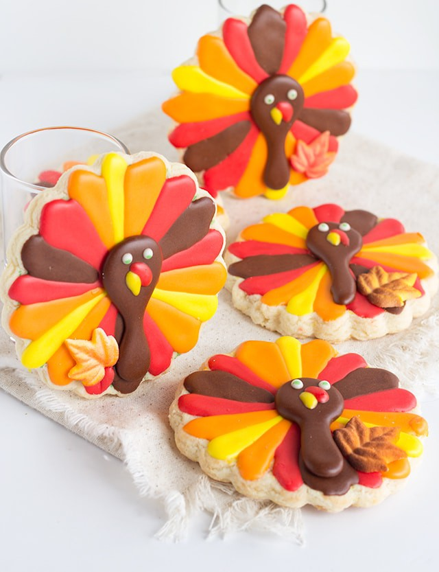 sugar cookies cut out and decorated to look like turkeys - Thanksgiving Turkey Cookies