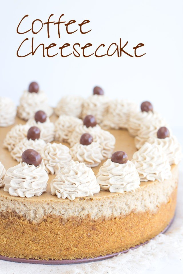 Coffee Cheesecake decorated with dollops of whipped cream and chocolate covered coffee beans
