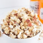 Maple Bacon Popcorn - Sweet and buttery maple coated popcorn with bits of crunchy, salty bacon. It's the perfect sweet and salty snack!