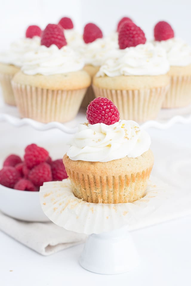 Raspberry Champagne Cupcakes - Kick off the new year with champagne cupcakes filled with a raspberry champagne filling and topped with a champagne frosting.