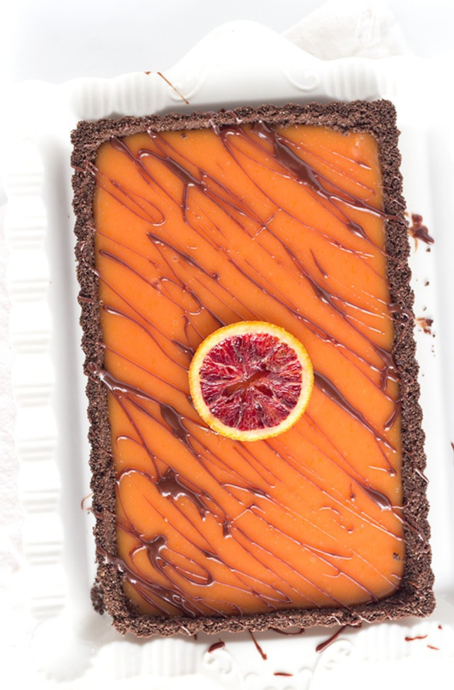 Chocolate Blood Orange Tart - chocolate graham cracker crusts with a blood orange curd and a milk chocolate ganache drizzle.