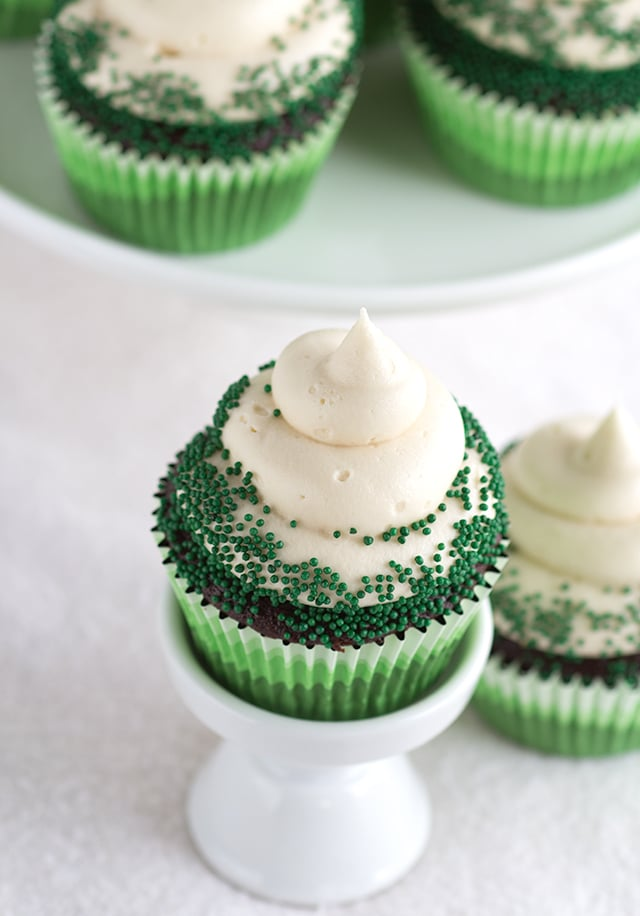 Chocolate Guinness Cupcakes with Baileys Cream Cheese Frosting - The perfect St. Paddy's Day dessert. It's boozy and chocolaty. The frosting is so creamy and thick, you'll love it!