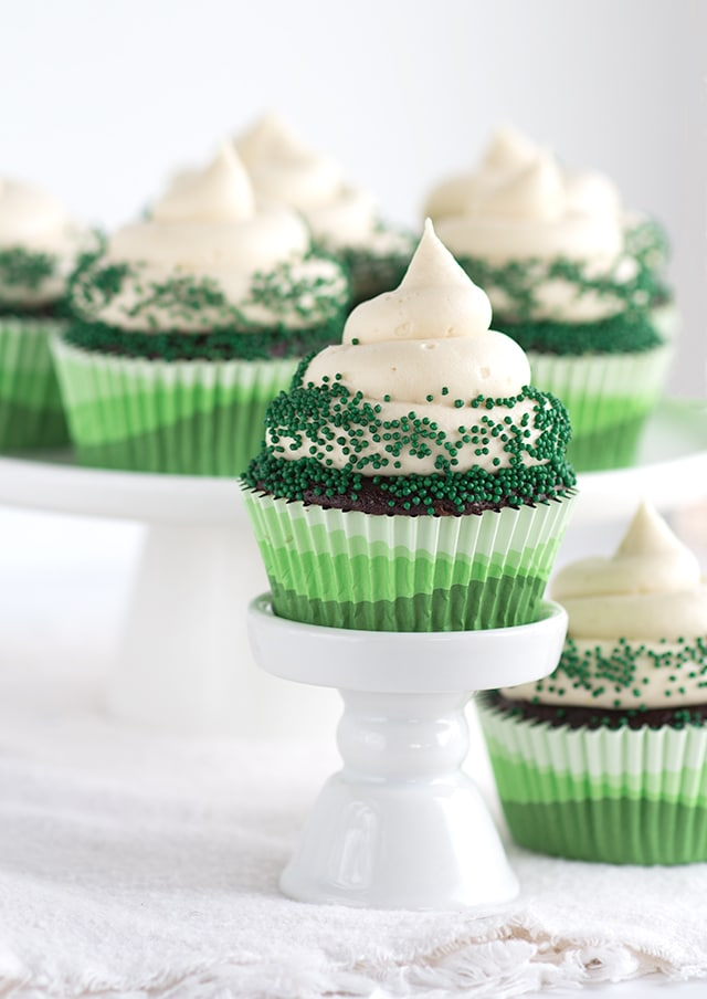 Chocolate Guinness Cupcakes with Baileys Cream Cheese Frosting - The perfect St. Paddy's Day dessert. It's boozy and chocolaty.