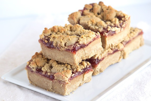 Peanut Butter Jam Bars - These bars have a peanut butter cookie base, a thick layer of strawberry jam, and a peanut butter crumble on top.