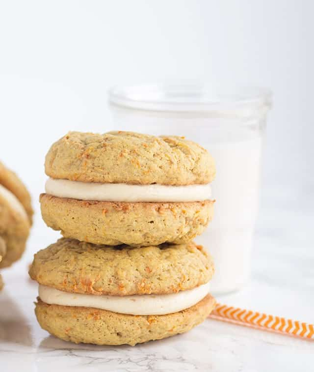 Peanut Butter Carrot Cake Whoopie Pies - peanut butter carrot cake cookies filled with a peanut butter cream cheese frosting.