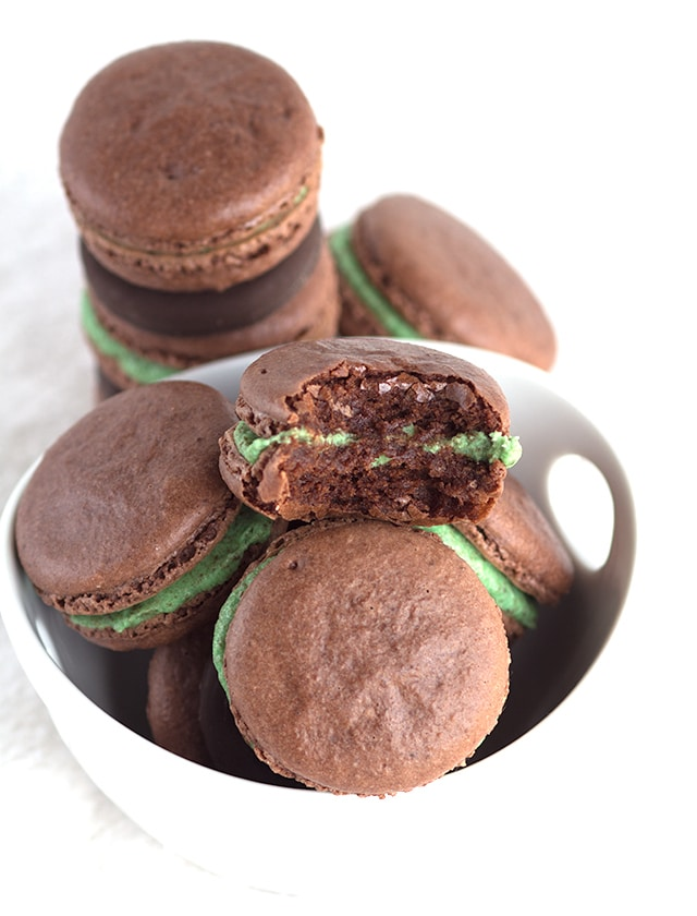 Thin Mint Chocolate Macarons - chocolate french macarons stuffed with a gorgeous green frosting is minty and packed full of crushed thin mint cookies.