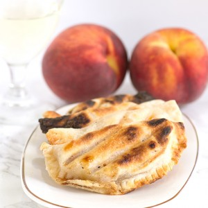 Grilled Peach Pies - delicious grilled peaches packed inside a pie crust and grilled until golden brown!