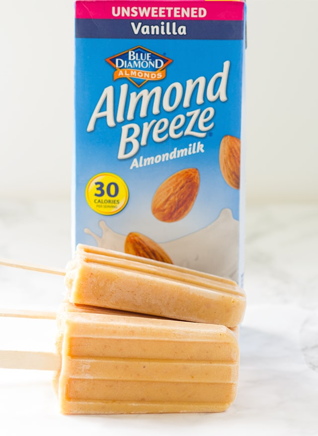 Peaches and Cream Ice Pops - lightly sweetened ice pops with roasted peaches and almond milk!