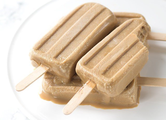 Boozy Caramel Coffee Popsicles - This is a simple 3 ingredient recipe that's for adults only! It's refreshing and will make any coffee lover's day!