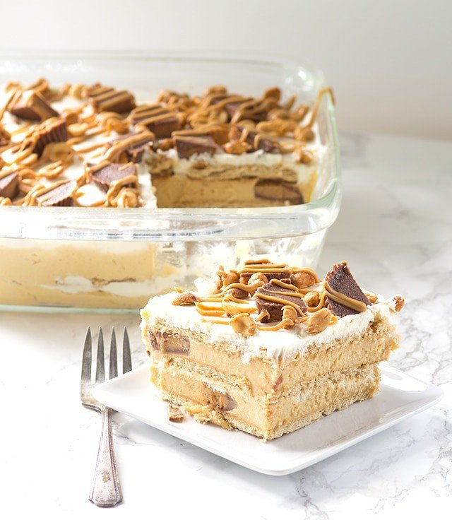 Peanut Butter Ice Box Cake - get your graham crackers ready! We're going to round up all of our goodies and make a killer ice box cake.