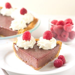 Chocolate Raspberry Pie - This is key lime pies friend, chocolate raspberry pie. The pie is loaded with fresh raspberry puree and chocolate flavored sweetened condensed milk.