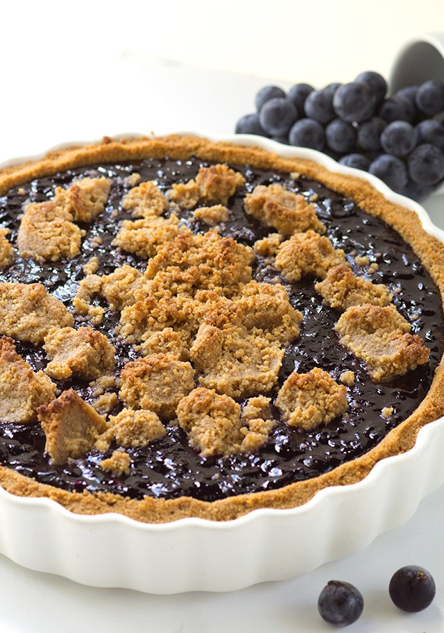 Concord Grape Tart with a Peanut Butter Cookie Crust and Crumb Topping.