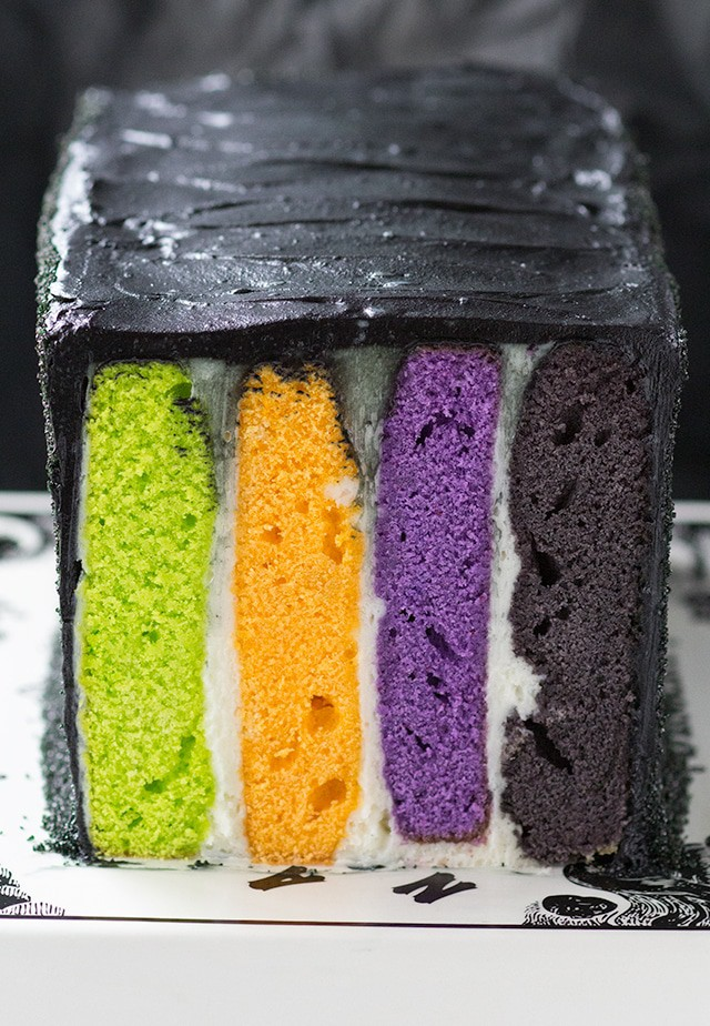 Halloween Cake - a fun and colorful halloween striped vanilla cake, cream cheese frosting and a black sanding sugar coating.