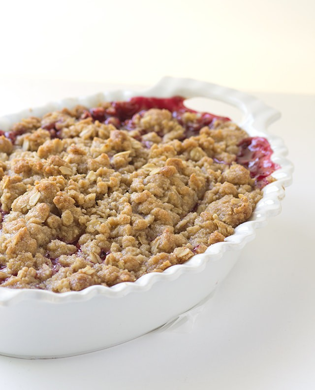 Raspberry Crisp - Grab a bowl and scoop some raspberry crisp in it and top it with some ice cream! The crisp topping is loaded with brown sugar and oatmeal. This is the perfect end of summer dessert!