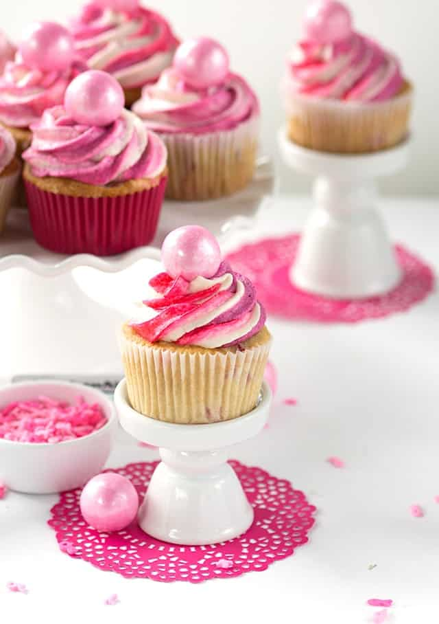 Strawberry Cupcakes - Vanilla cupcakes with finely diced strawberries mixed into the batter. The cupcakes are topped with pinks in honor of breast cancer awareness!