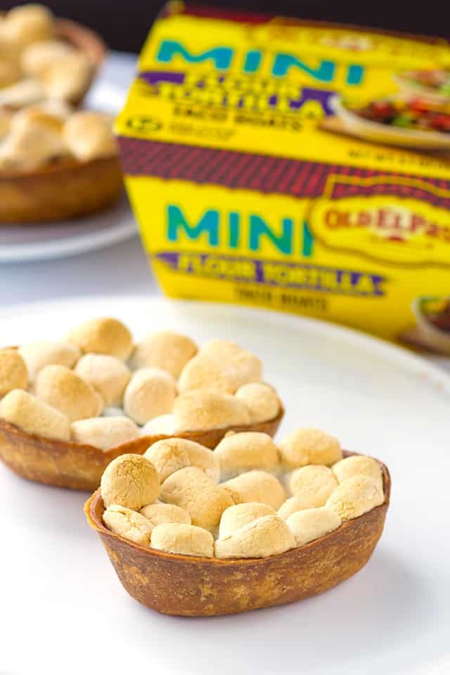 Chili Smores Taco Boats - the perfect sweet game day appetizer. It has a bit of heat and comes in a tiny taco boat too!