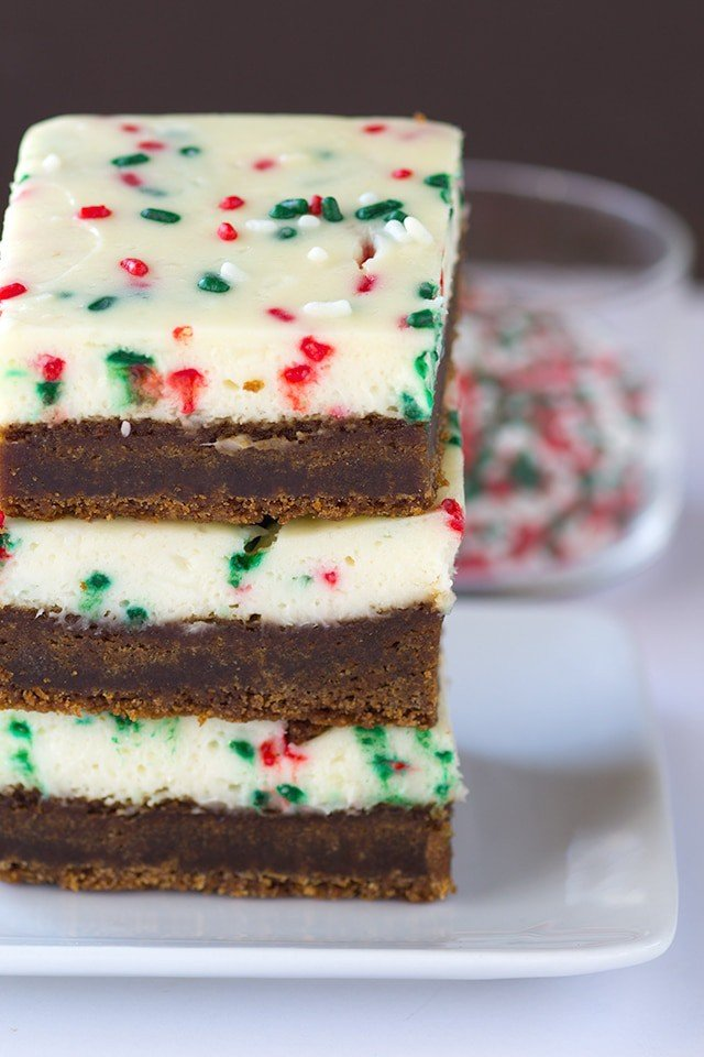 Molasses Cheesecake Bars - a dense and soft molasses cookie layer with a festive sprinkle packed cheesecake top.