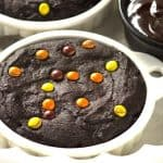 Chocolate Cookies For Two - rich chocolate cookies with a chocolate candy bar center and topped with some peanut butter filled candies. The perfect dessert for two!