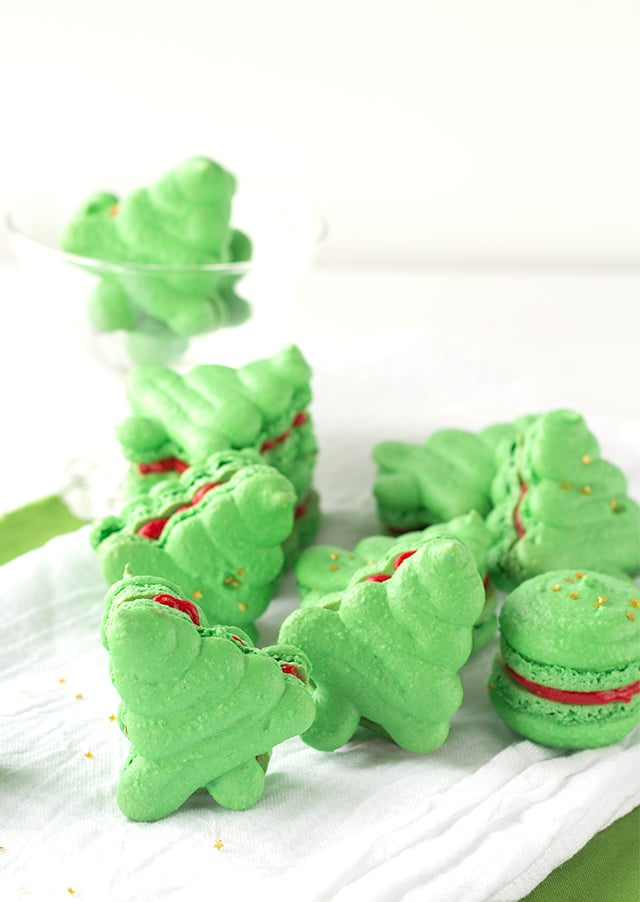 gorgeous Christmas tree shaped French macarons with a bright red buttercream frosting filling