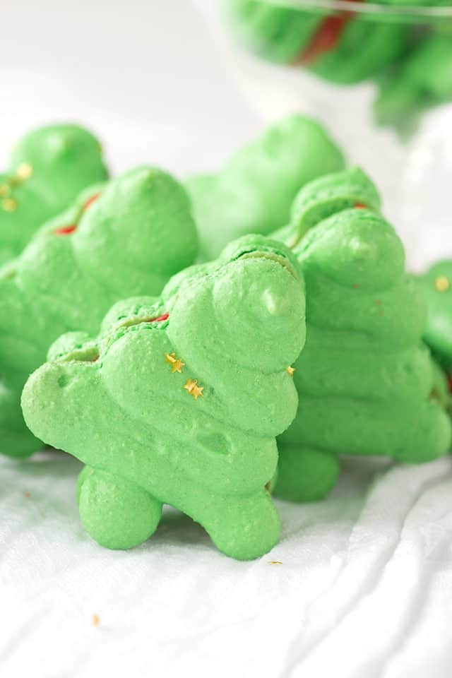 close up image of Christmas Macarons - French macarons shaped like Christmas trees
