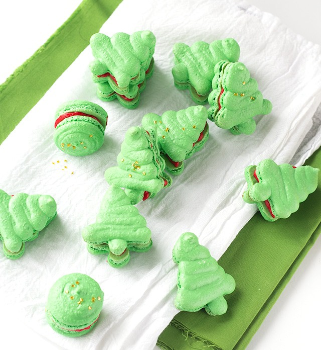 green Christmas tree macarons cookies filled with red vanilla buttercream frosting
