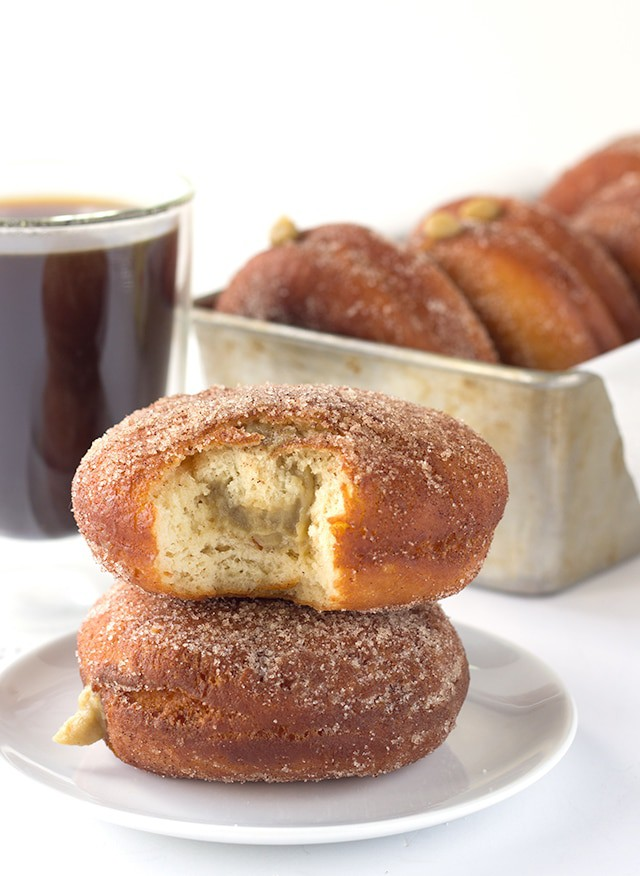 Coffee Custard Filled Donuts - Deep fried donuts filled with a sweet coffee custard. These donuts make the most irresistible breakfast and dessert!