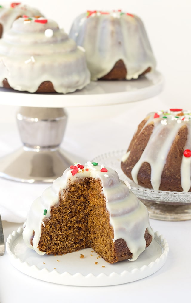 Gingerbread Bundt Cakes - the perfect little cakes for Christmas, They're full of molasses , spices, and the perfect gingerbread flavor! Top the little cakes with a white chocolate ganache and sprinkles for the finishing touch.