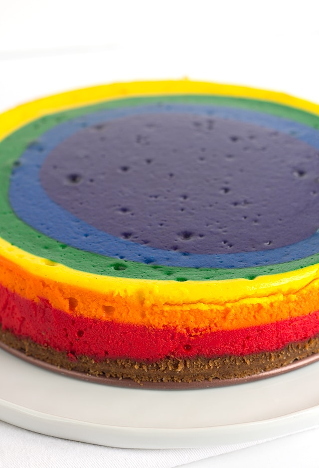 Vibrant rainbow colored vanilla bean cheesecake that's perfect for St. Patrick's Day